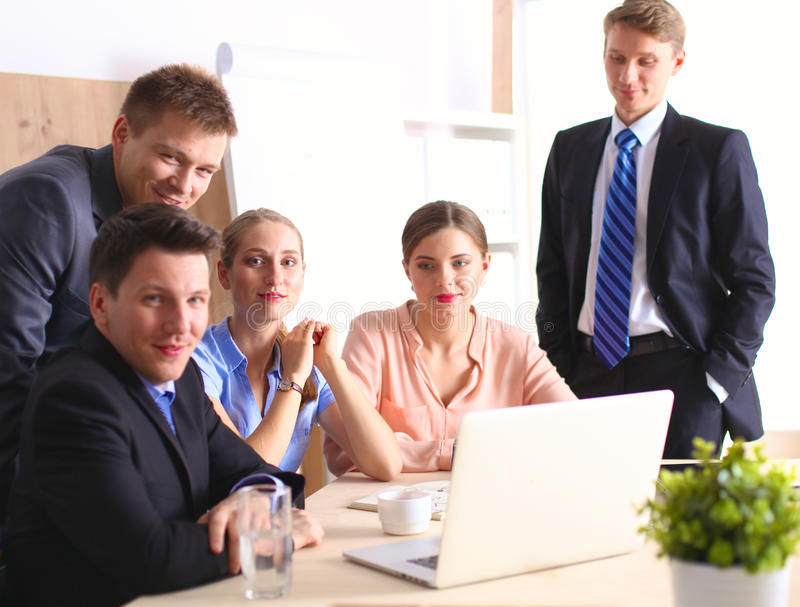 Business meeting - manager discussing work with his colleagues.  royalty free stock photo