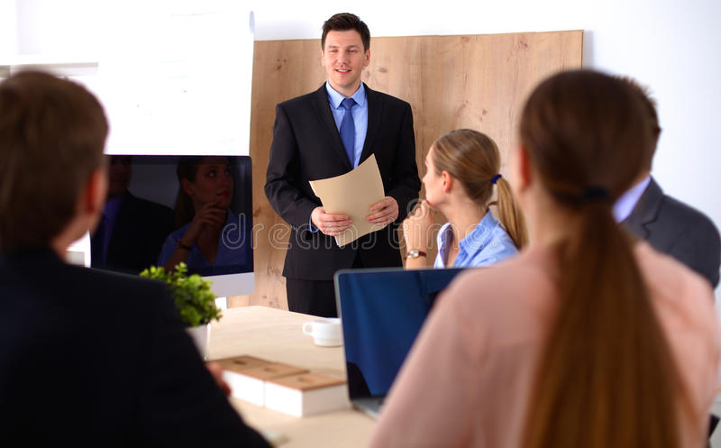 Business meeting - manager discussing work with his colleagues royalty free stock photography