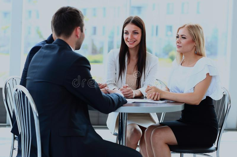 Business meeting - manager discussing work with his colleagues. royalty free stock images