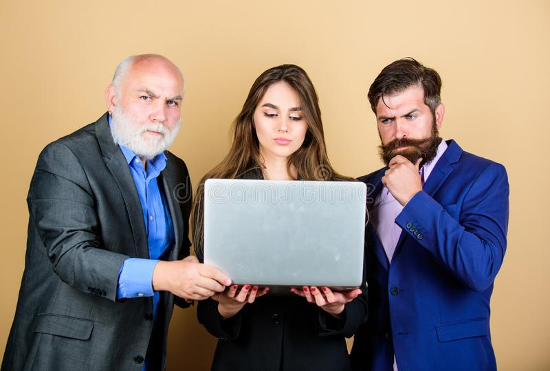 Business meeting. Men bearded manager show financial report laptop. Woman and guy colleague working together. Business stock photography