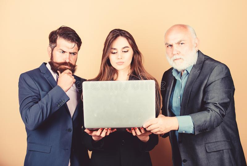 Business meeting. Men bearded manager show financial report laptop. Woman and guy colleague working together. Business royalty free stock images