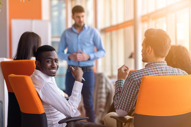 Business meeting in a modern office with young people stock photo