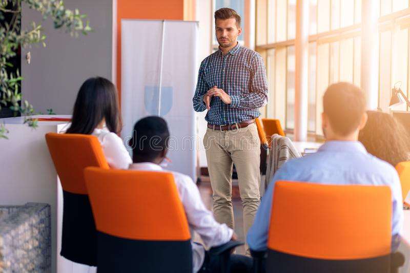 Business meeting in a modern office with young people stock photography
