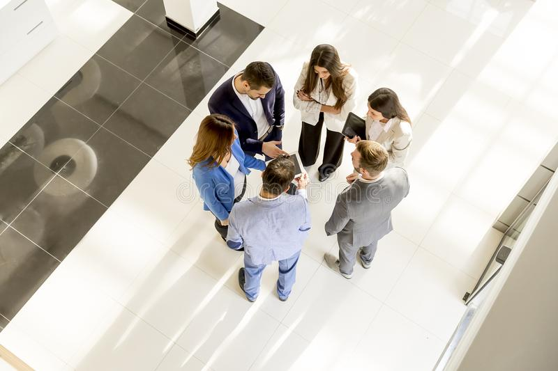 Business meeting. Overhead view of people having business meeting royalty free stock image