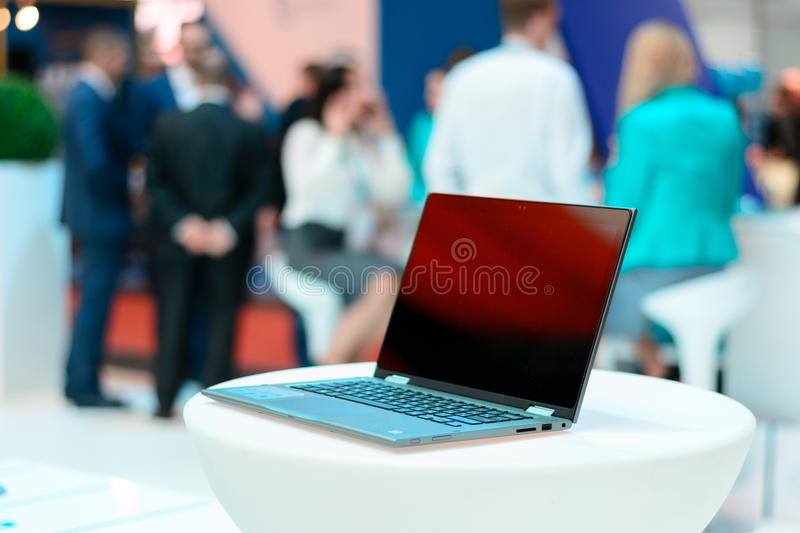 Business meeting place. Close-up of comfortable working place in modern office with white table and laptop on it. Business concept royalty free stock photo