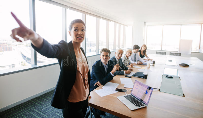 Business meeting and presentation in conference room stock photos