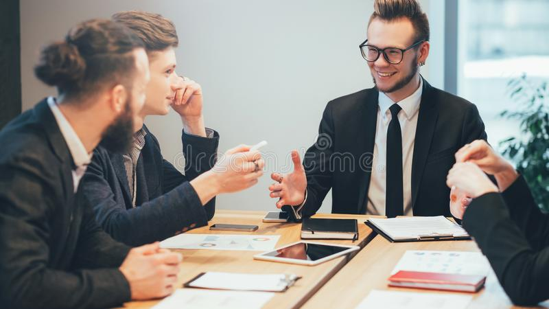 Business meeting project manager instructions. Business meeting. Young male project manager giving instructions to professional team royalty free stock image