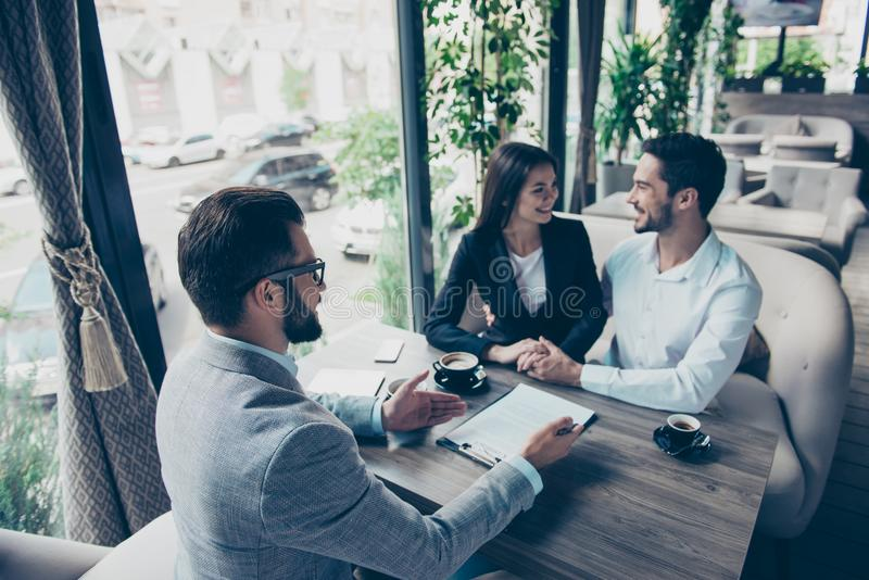Business meeting at the restaurant. Happy couple is buying new h royalty free stock image