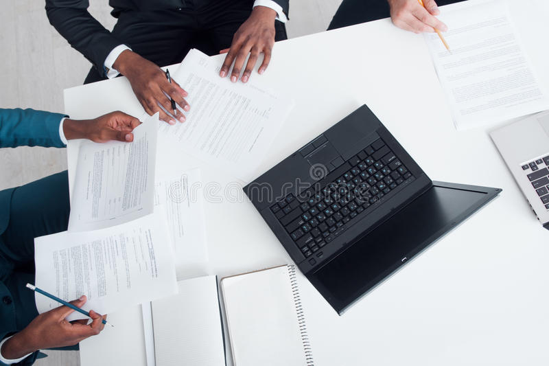 Business meeting, signing contracts and documents stock photography