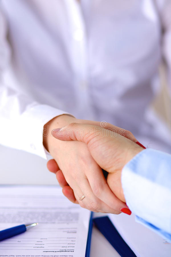 Business meeting at the table shaking hands conclusion of the contract.  royalty free stock photography