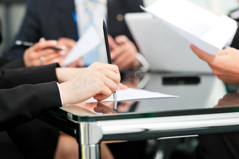 Business meeting with work on contract stock photos