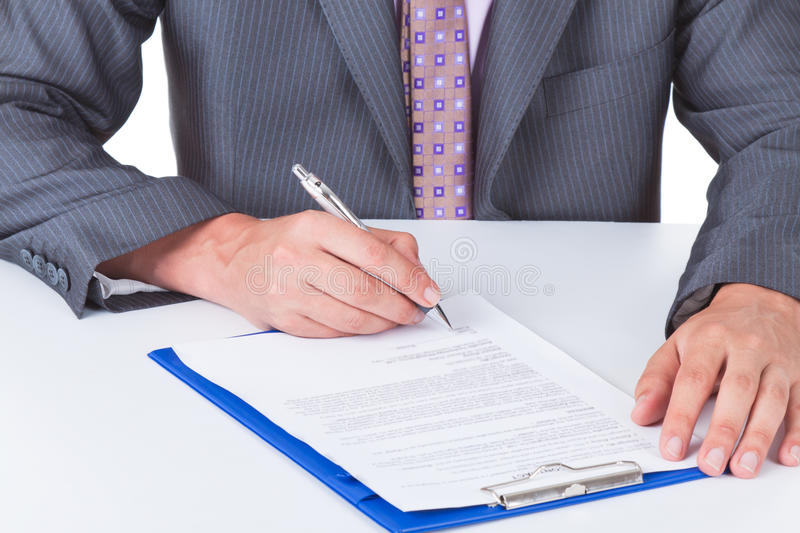 Business men. Business man in elegant suit signing up contract royalty free stock image