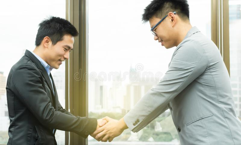 Business men is dealing business by shaking their hands stock photo
