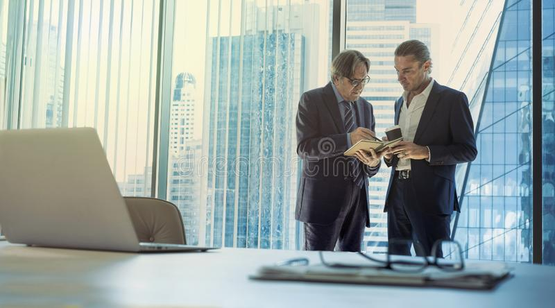 Business men discussing at the office stock photos