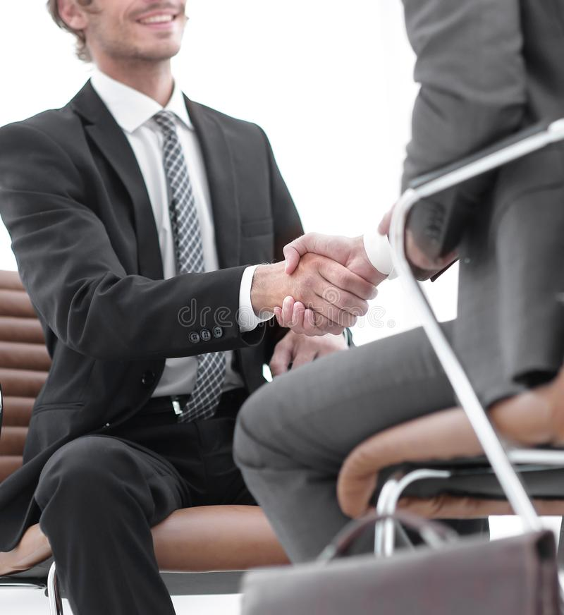 Close-up of a businessman holding a briefcase. Business men hands with briefcase royalty free stock images