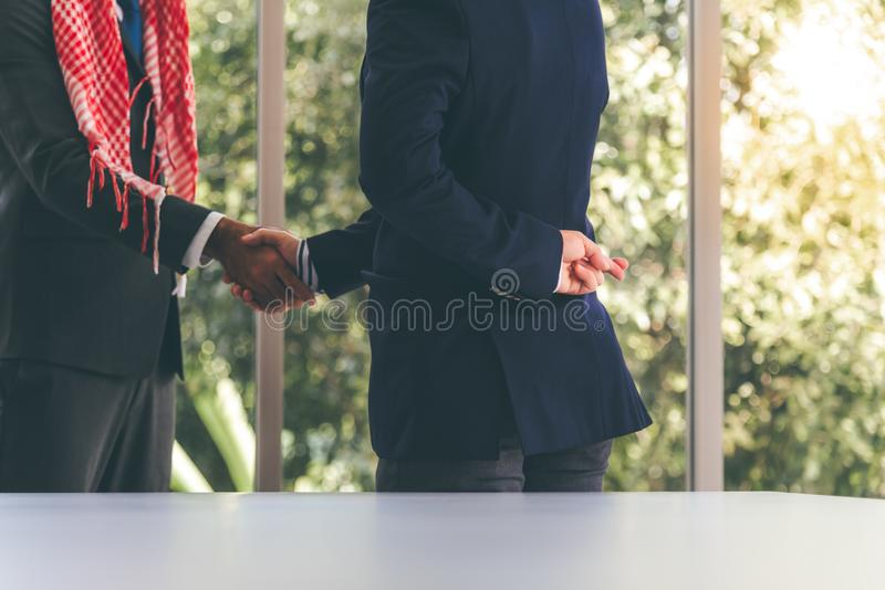 Business men he left finger cross back. The business men he left finger cross back, while using the join hand with agreements with business partners, which is a stock image