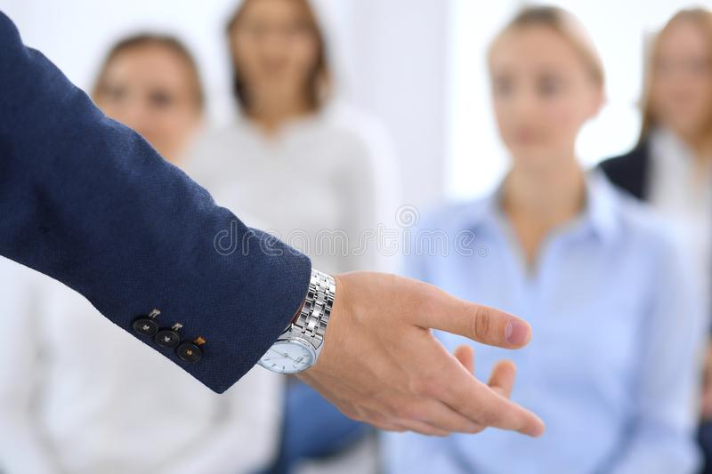 Business man making presentation to group of people. Speaker delivering a seminar to his colleagues or business training stock image