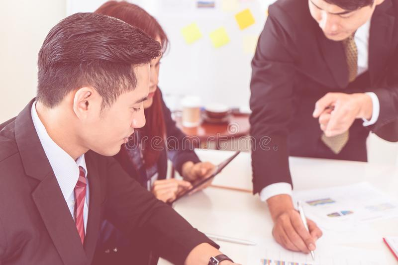 Business man marking on data sheet using pen in meeting stock photography