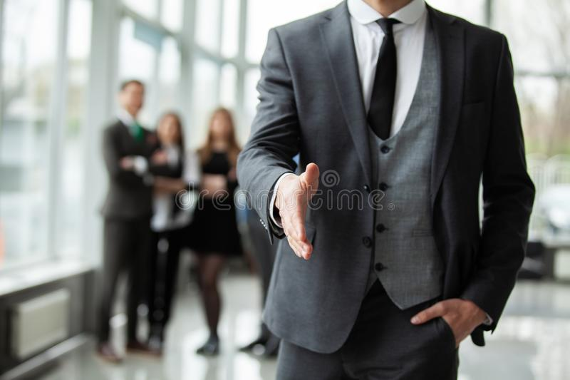 A business man with an open hand ready to seal a deal. A business men with an open hand ready to seal a deal stock image