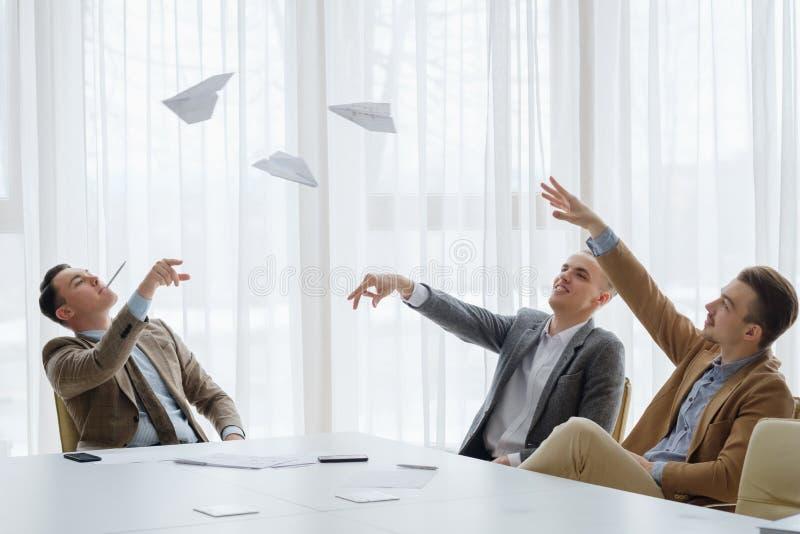 Business men paper plane meeting break fun stock image
