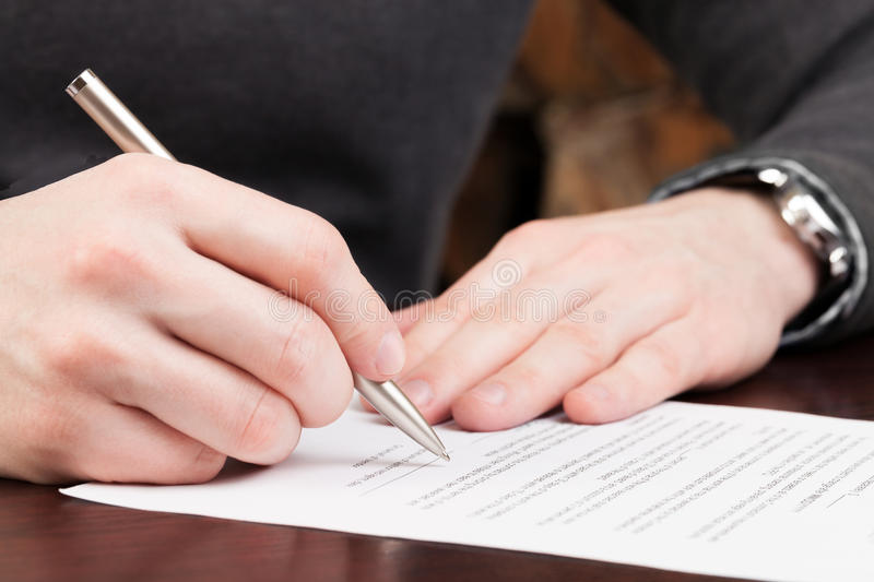 Business men reading contract. royalty free stock photos