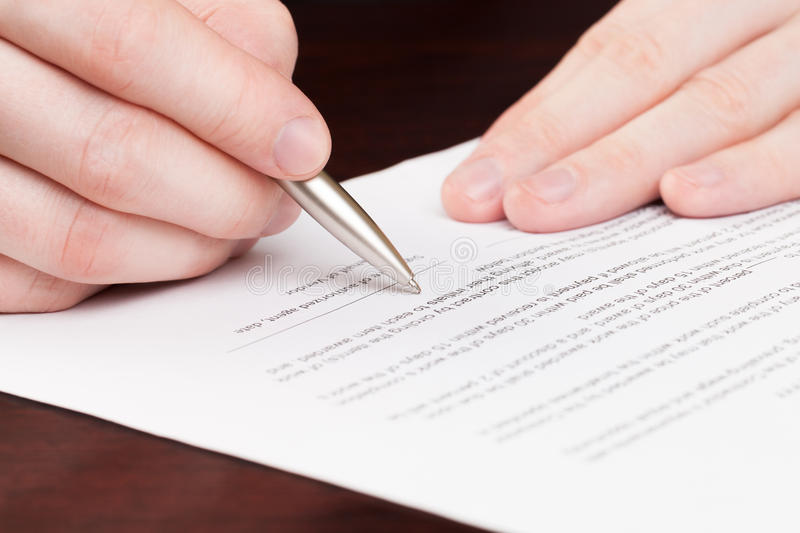 Business men reading contract. stock image