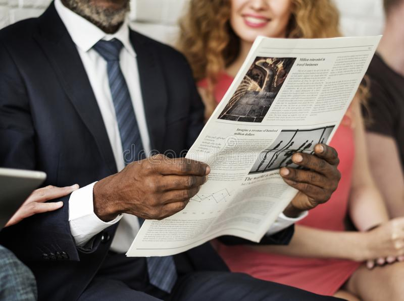 Business man reading newspaper concept stock photos