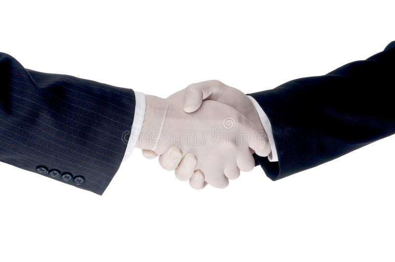 Business men shake hands wearing protective gloves. Business men shaking hands wearing gloves to protect against flu virus stock image