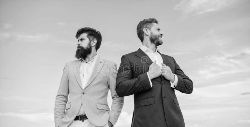 Business men stand blue sky background. Business people concept. Well groomed appearance improves business reputation stock photos