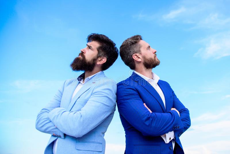 Business men stand blue sky background. Perfect in every detail. Well groomed appearance improves business reputation. Entrepreneur. Business people concept royalty free stock images