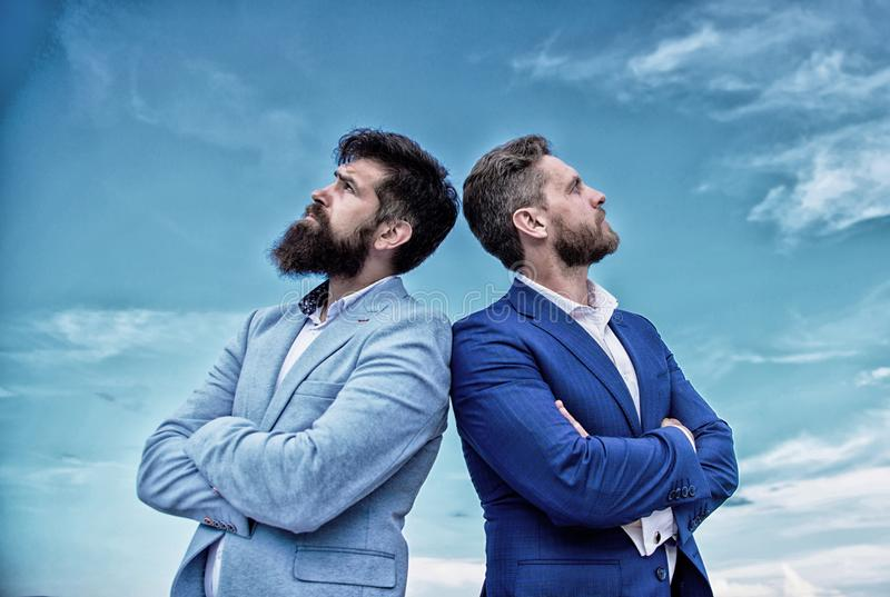 Business men stand blue sky background. Perfect in every detail. Well groomed appearance improves business reputation. Entrepreneur. Business people concept stock photos