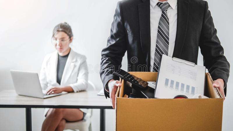 Business man stressing with resignation letter for quit a job packing the box and leaving the office , Resignation concept. Business men stressing with stock photo