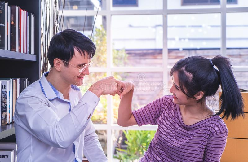 Business man and woman business fist bump hand together for team work stock images