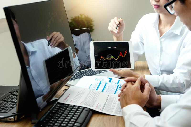 Business man and woman sit at ther table stock photos