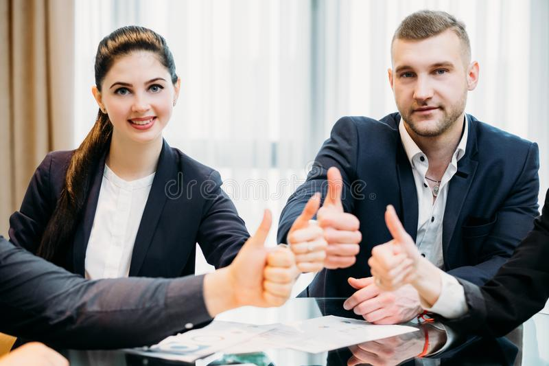 Business men women thumb up professionals work royalty free stock photography