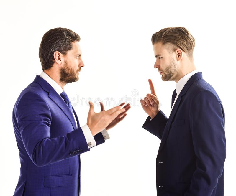 Business misunderstanding concept. Business partners discussing. Problems, isolated on white background. Men in suits or businessmen with tense faces and hands royalty free stock photo