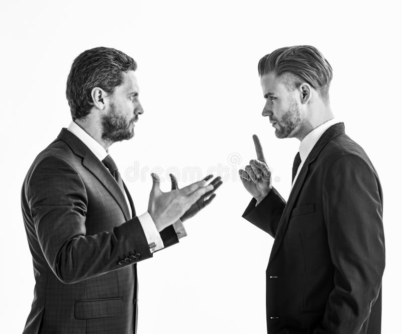 Business misunderstanding concept. Business partners discussing problems, isolated on white background. Men in suits or. Businessmen with tense faces and hands stock image