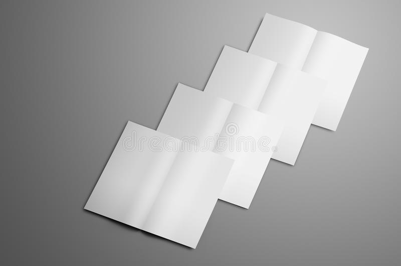 Business mockup with white four A4, A5 bi-fold brochures. Isolated on gray background. The booklets lie in order one on one the each top brochure is pushed down stock photography