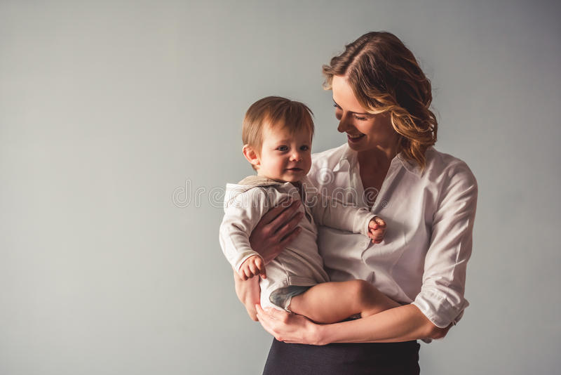 Business mom and baby boy stock photo