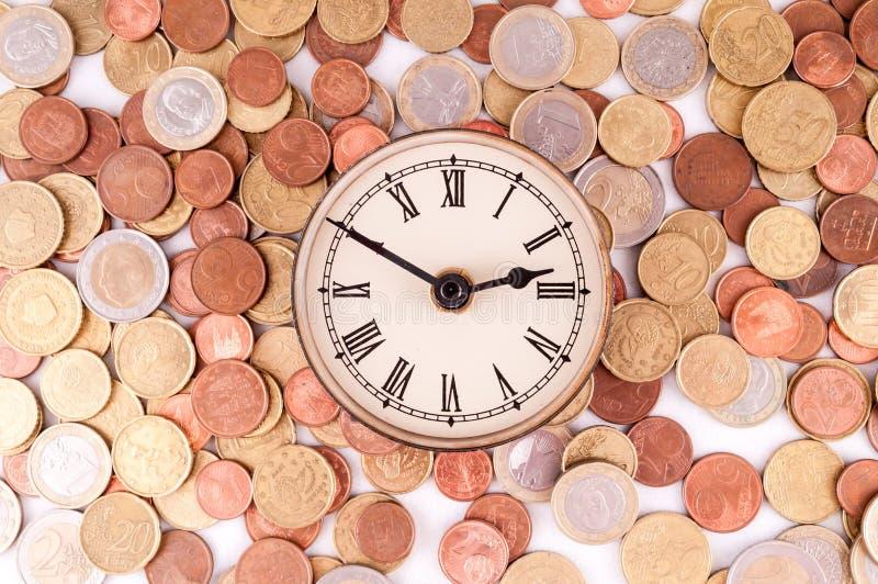 Business Money Concept Idea. Picture of a Business Money Concept Idea, Clock and Coins stock photography