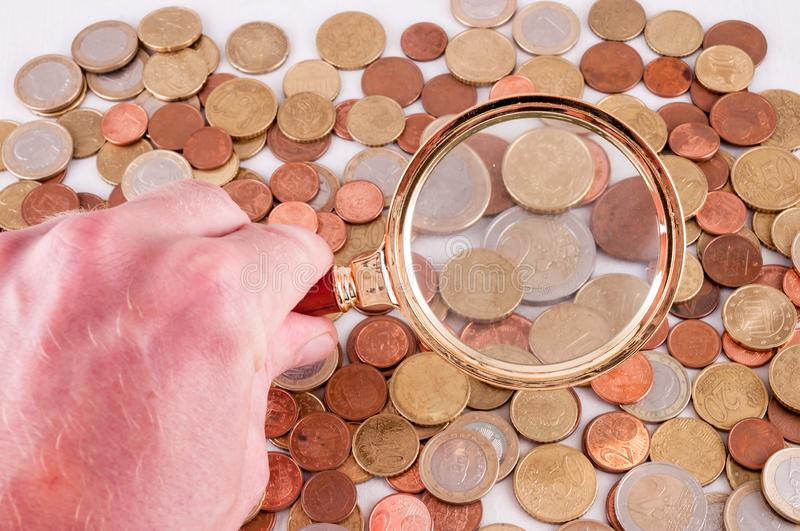 Business Money Concept Idea. Picture of a Business Money Concept Idea Coins and Loupe Magnify Glass stock images
