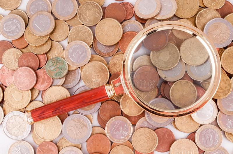 Business Money Concept Idea. Picture of a Business Money Concept Idea Coins and Loupe Magnify Glass royalty free stock photography