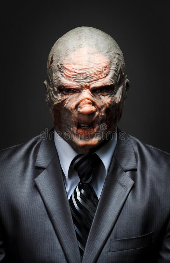 Business monster. Angry monster in business suit royalty free stock image