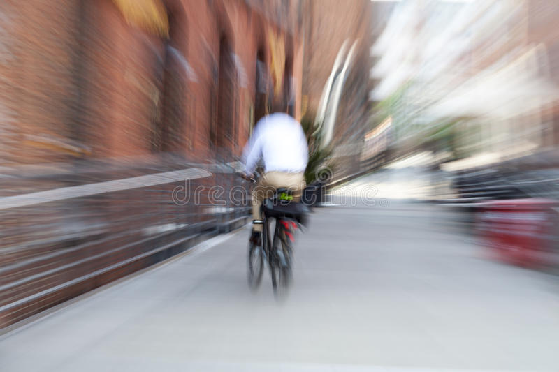 Business on the move. Cyclist driving stock image