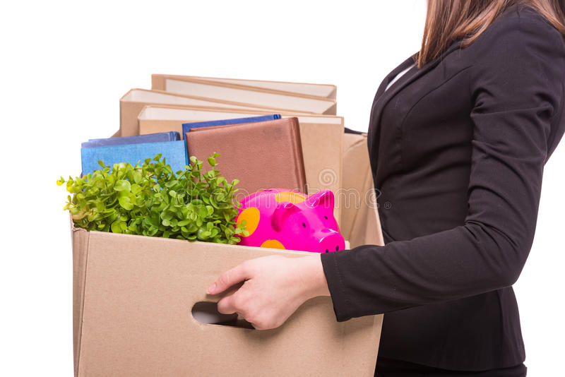 Business move. Side view. Business woman holding box with office items. isolated on white background stock photo