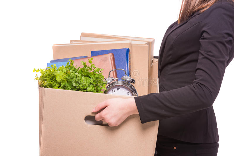 Business move. Side view. Business woman holding box with office items. isolated on white background stock images