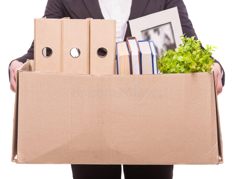 Business move. Business woman holding box with office items. isolated on white background royalty free stock photography