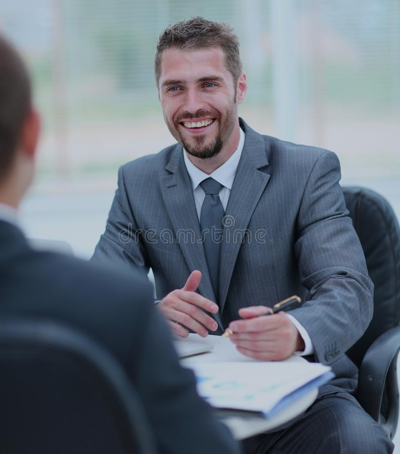 Business negotiations. Two businessmen talking in the office stock images