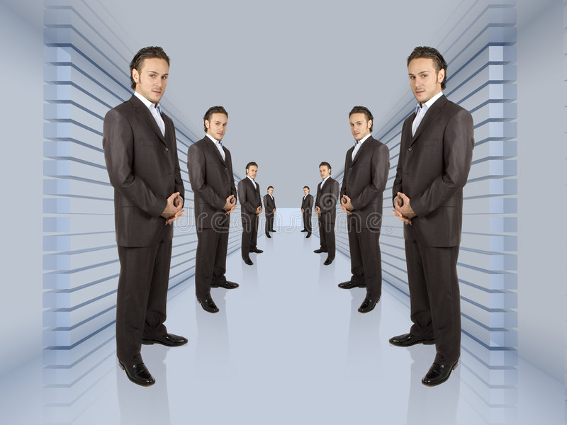 Business network. Business people lined up in a long hallway stock image