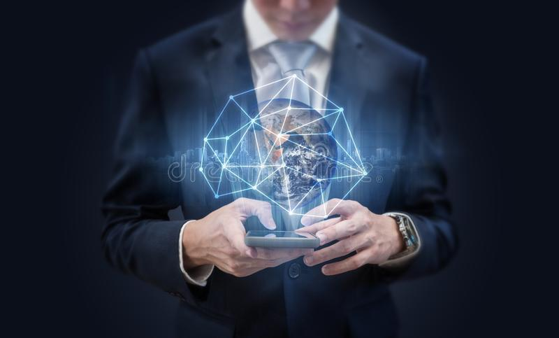 Business network communication technology. Businessman using mobile phone and global network technology. Element of this image are. Business network stock images